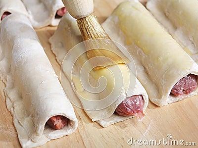 Glazing sausage rolls