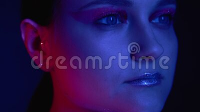 Glitter art makeup woman shiny eyeshadow lip gloss. Glitter art makeup. Fashion beauty. Peaceful woman with shiny eyeshadow lip gloss in pink blue glow stock footage