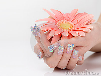 Glitter manicure and pink flower