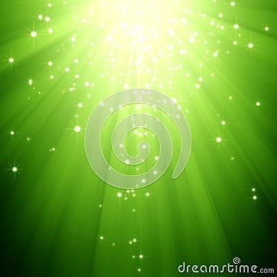 Glitter stars descending on green light burst