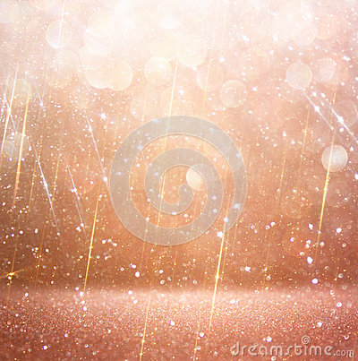 Glitter vintage lights background. abstract gold background. defocused