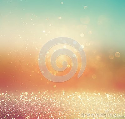 Glitter vintage lights background. gold, silver, blue and white. abstract blurred image. Stock Photo