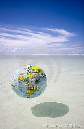 Globe floating in tropic sea