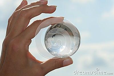 Globe in hand