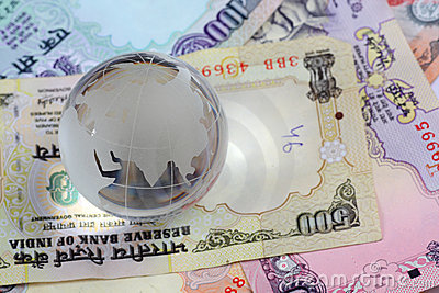 Globe on indian currency rupees notes