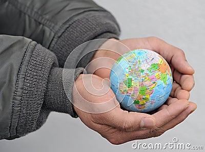 Globe in man s hands