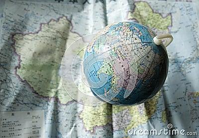Globe on map of China