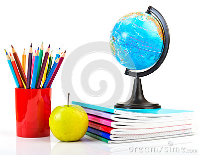 Globe, notebook stack and pencils.