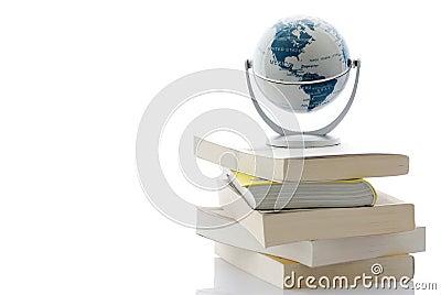 Globe on pile of books