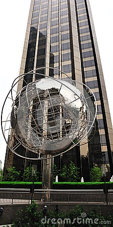 Globe structure at Columbus Circle with cityscape