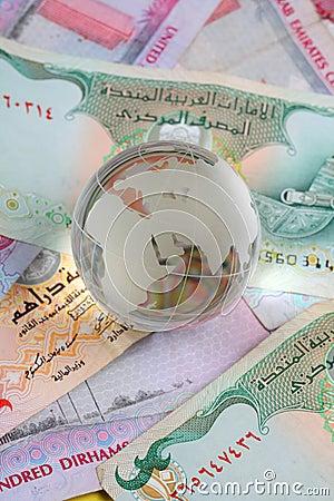 Globe on uae currency dirham notes