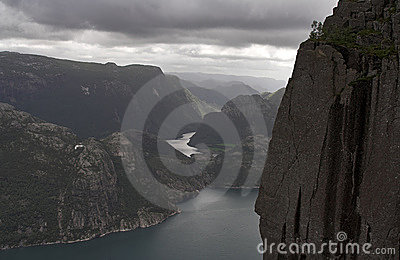 Gloomy fjord landscape - mountains cliffs and water