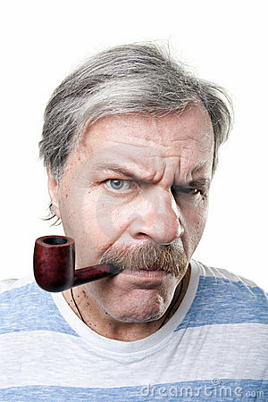 Gloomy mature man with smocking pipe isolated