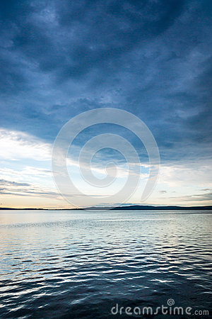 Gloomy sky above lake water