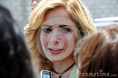 Gloria Trevi on a street interview. Editorial Image