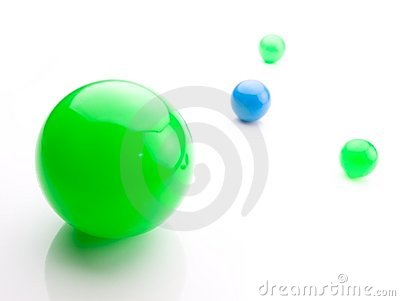 Glossy green and blue spheres on white.