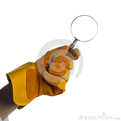 Glove holding a magnifying glass