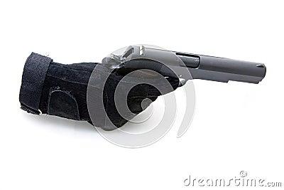 Gloved hand and gun