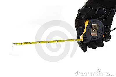 Gloved hand holding a measuring tape