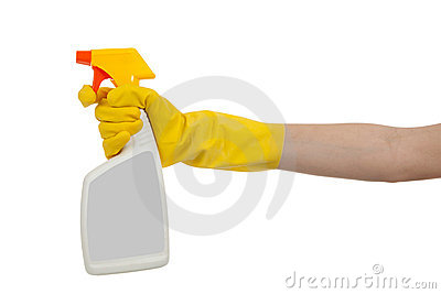 Gloved hand with spray bottle with copy space Stock Photo