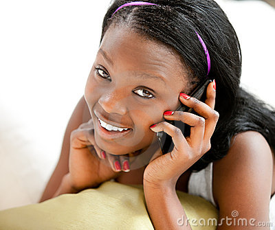 Glowing afro-american teenager talking on phone