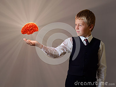 Glowing brain of the child hand