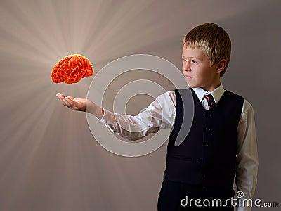 Glowing brain of the child hand
