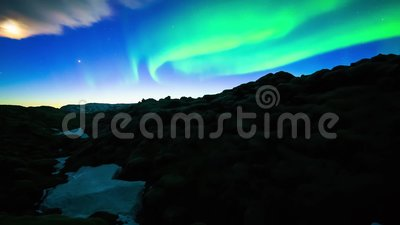 Glowing bright neon green northern lights aurora borealis moving in deep blue night sky in stunning 4k time lapse view. Glowing bright neon green northern lights stock video