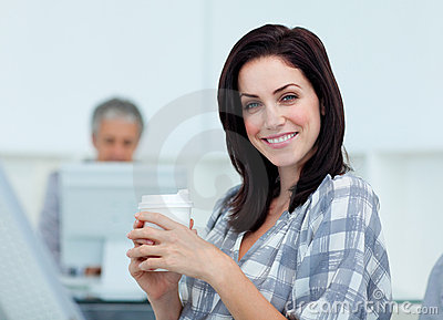 Glowing businesswoman drinking a coffee