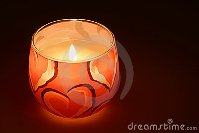 Glowing candle in the dark