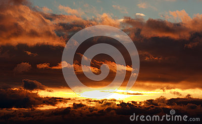 Glowing dramatic sunset clouds in sky, nature background Stock Photo