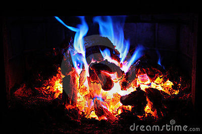 Glowing fire embers at night