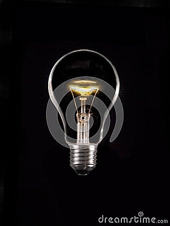 Glowing lamp on black