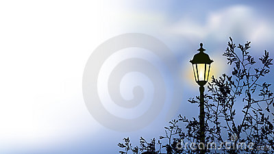 Glowing lantern near the branches of spring tree