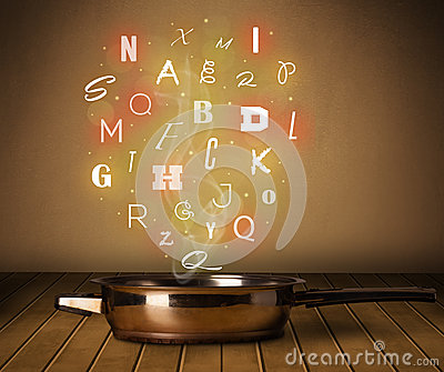 Glowing letters coming out from cooking pot Stock Photo
