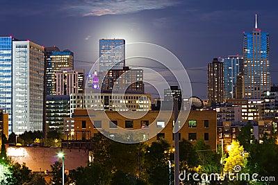 Glowing Moon Rises Behind The Denver Skyline