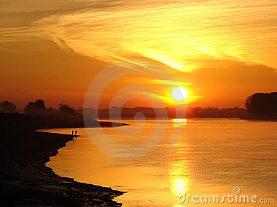 Glowing sunrise over river