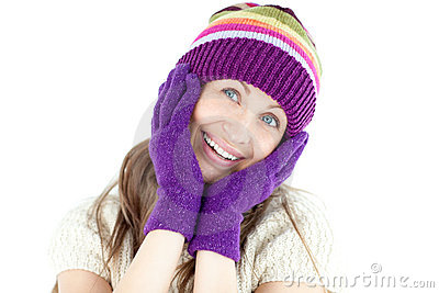Glowing woman wearing gloves and cap