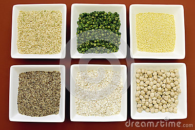 Gluten free grains food - brown rice, millet, LSA, buckwheat flakes and chickpeas and green peas legumes - aerial close-up.