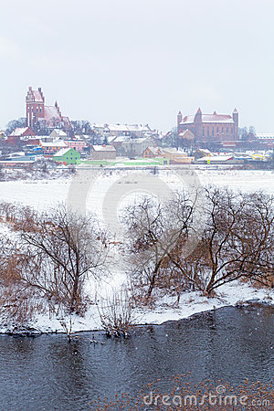 Gniew town in winter scenery at Wierzyca river