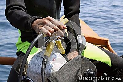 go dive scuba diver holding tank philippines