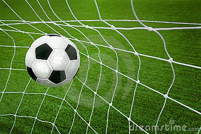 Goal. a soccer ball in a net.