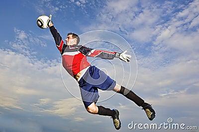 Goalie jumps to catch soccer ball