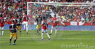 Goalie makes save for Arsenal Editorial Stock Image