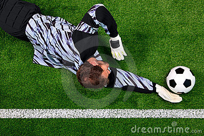 Goalkeeper diving to save the ball