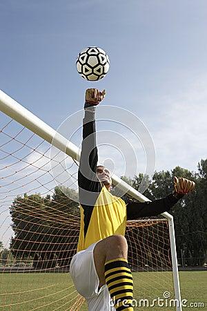 Goalkeeper reaching for ball