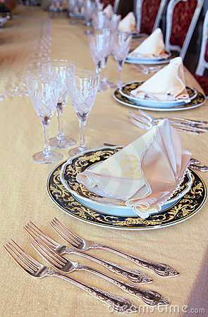 Goblets, forks and plates with placemat