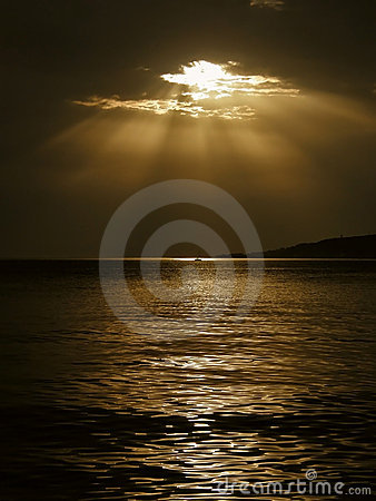 Free God S Rays And A Boat On The Sea Royalty Free Stock Photography - 16763047