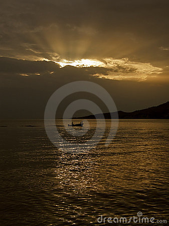 Gods rays and  boat