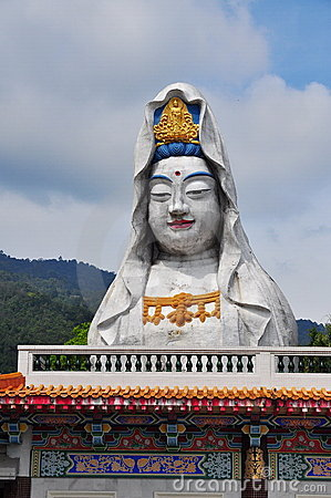 Goddess of Mercy statue on temple roof